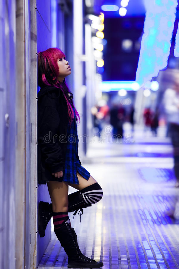 Urban portrait. Young beautiful asian girl in nocturne urban scene royalty free stock photo