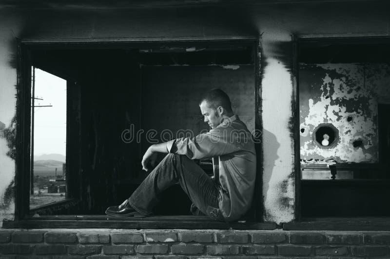 Urban portrait of man sitting outdoors stock photos