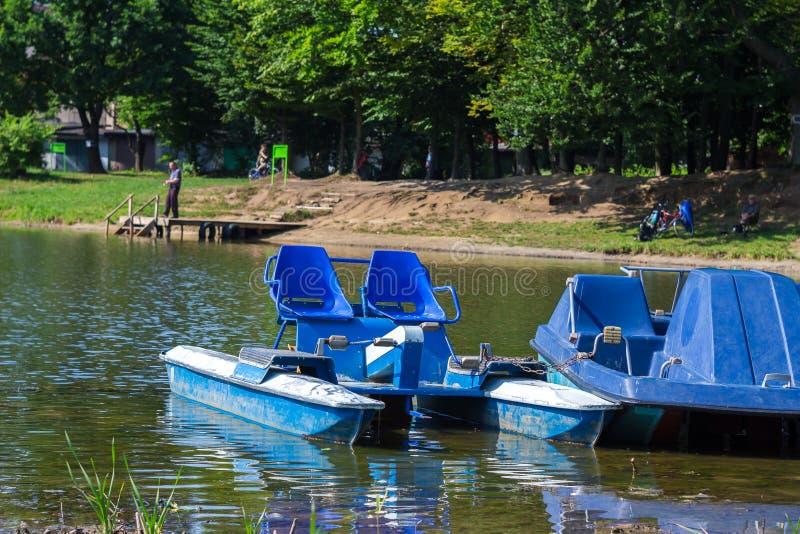 Urban recreational lake park catamarans in water royalty free stock photo
