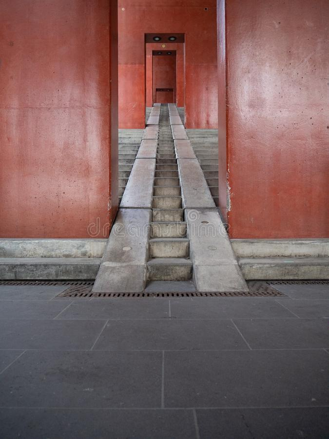 Urban red staircase in cologne Lanxess Arena royalty free stock images