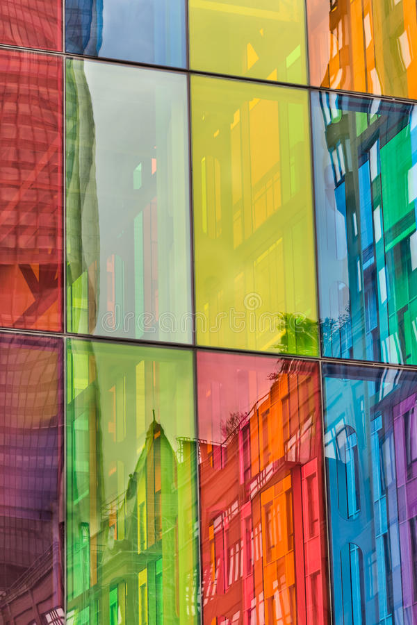 Urban reflections on colored windows of Convention Center Montreal stock image