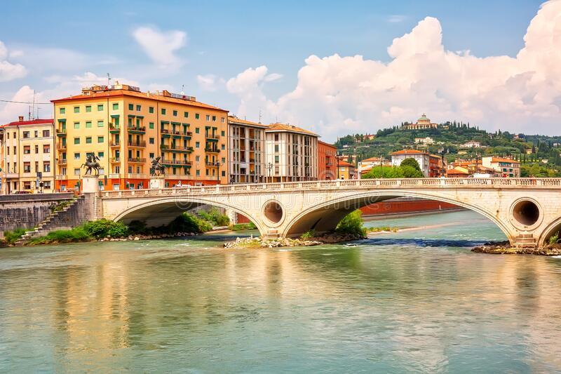 Urban riverscape with old historic bridge and buildings, Verona, Italy.  stock photography
