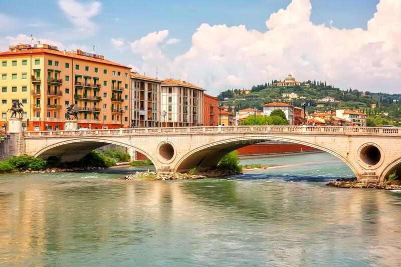 Urban riverscape with old historic bridge and buildings, Verona, Italy.  royalty free stock image