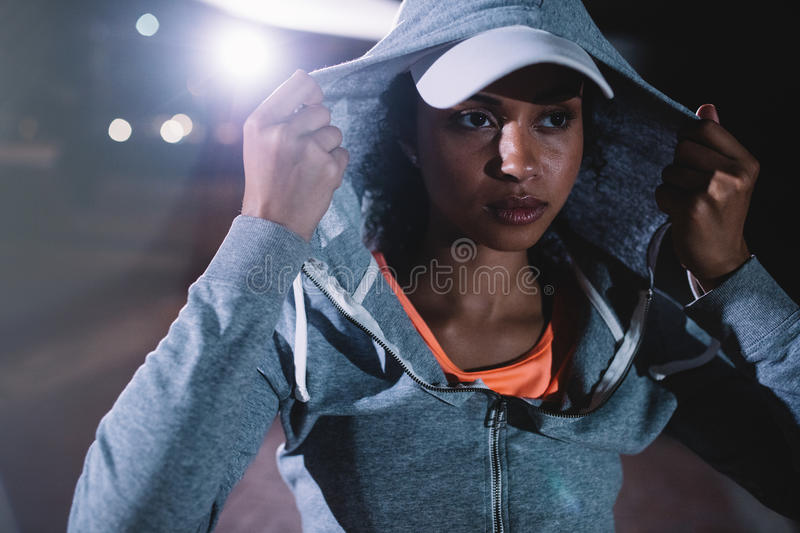 Urban runner standing on the street at night stock photography