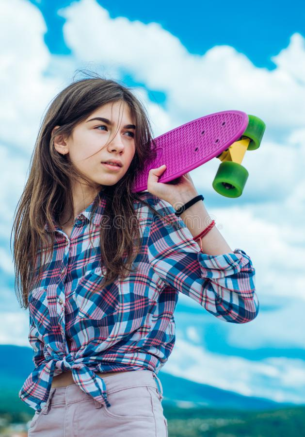 Urban scene, city life. ready to ride on the street. skateboard sport hobby. Summer activity. Hipster girl with penny. Board. plastic mini cruiser board. Spring stock photography