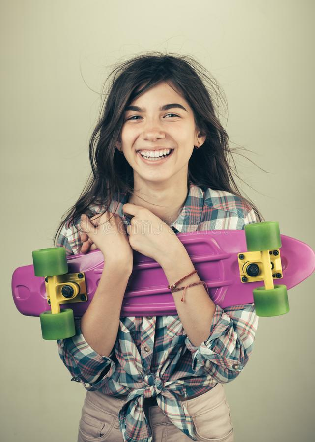 Urban scene, city life. ready to ride on the street. skateboard sport hobby. Summer activity. Hipster girl with penny. Board. plastic mini cruiser board. Spring royalty free stock photos