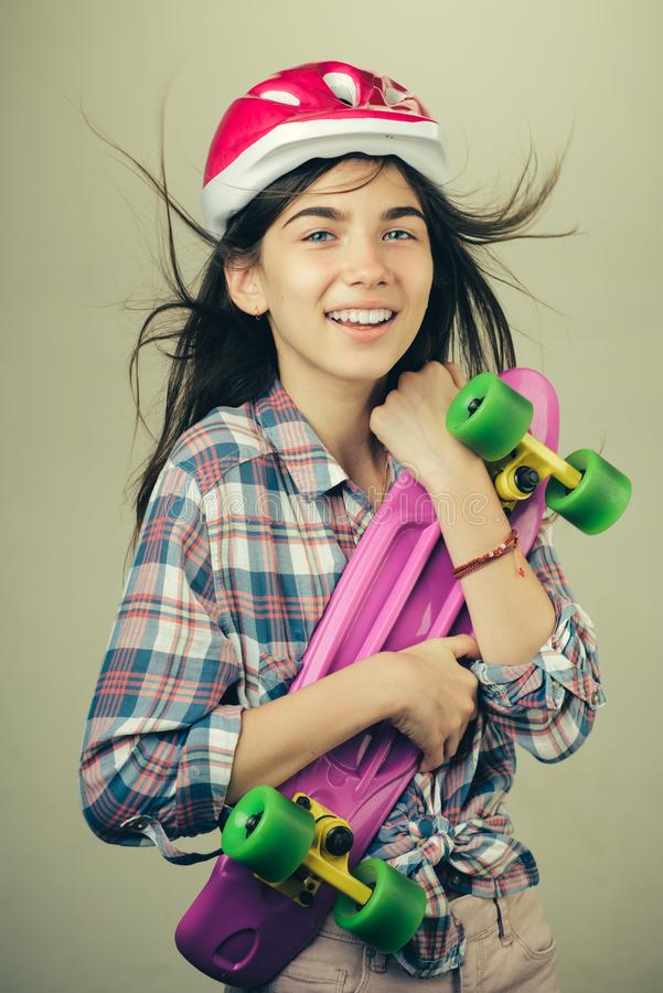 Urban scene, city life. skateboard sport hobby. Summer activity. ready to ride on street. plastic mini cruiser board. Spring. Hipster happy girl with penny stock images