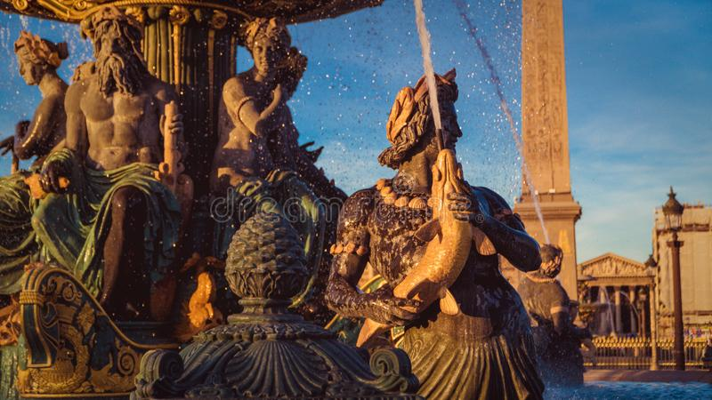 Fontaine des Mers under Paris Sunset. Urban scene. Concord Square, detail of the Mers fountain and the Obélisque de Louxor over the Paris afternoon, sunset stock photography
