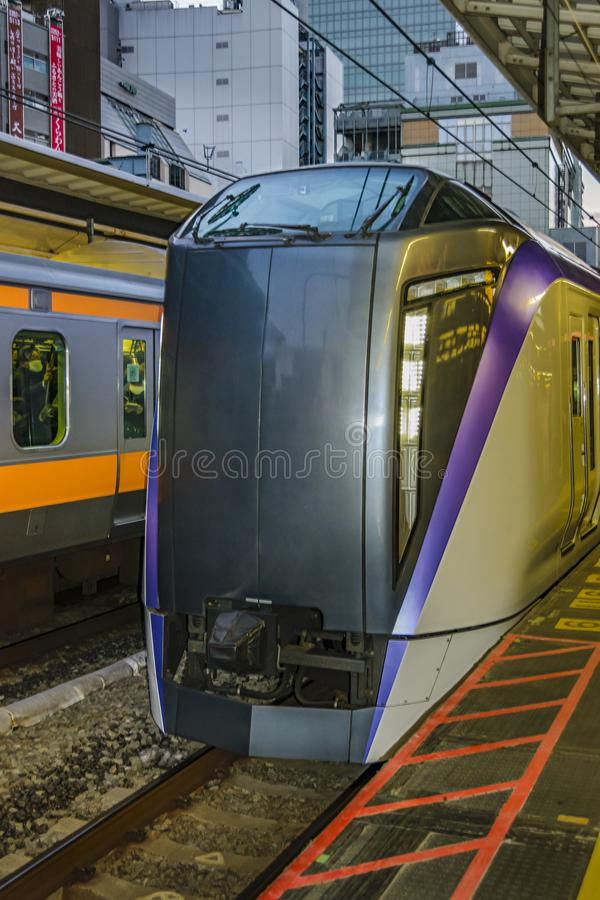 Train Arriving to Station, Tokyo, Japan stock photos