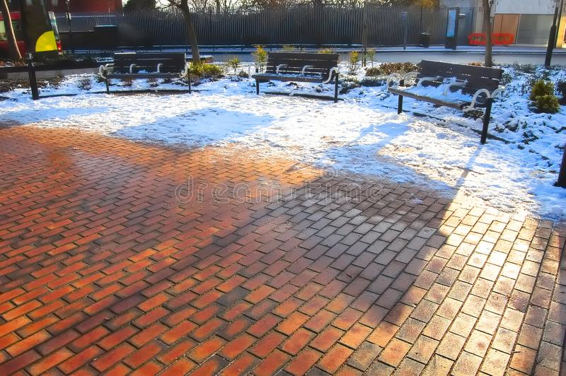 Urban seating area in the snow. Copy space, background royalty free stock photos