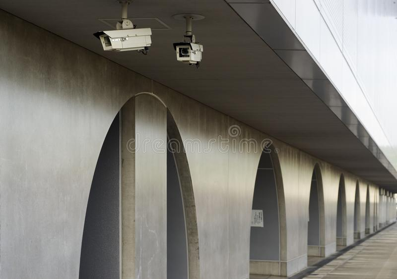 Urban security cameras. Security cameras on wall in public space outdoor of Kyoto railway station stock photos