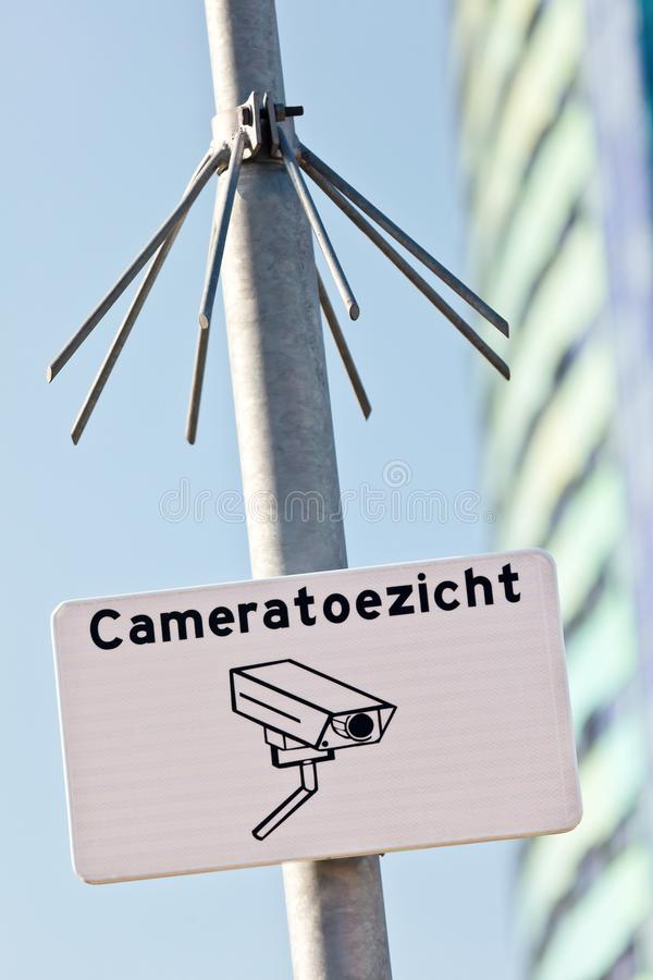 Urban security sign with the Dutch text `Camera surveillance. ` in The Netherlands royalty free stock image