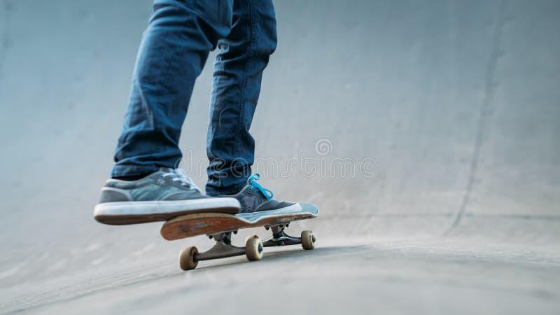 Urban skater man skateboard legs jeans ramp royalty free stock image