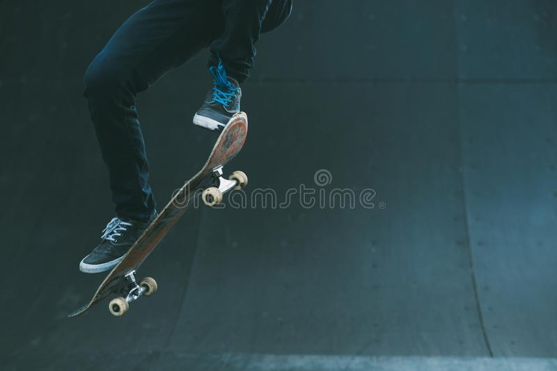 Urban skater trick skate ramp man jumping. Urban skater in action. Ollie trick. Skate park ramp. City area. Man on skateboard jumping. Copy space for text royalty free stock image