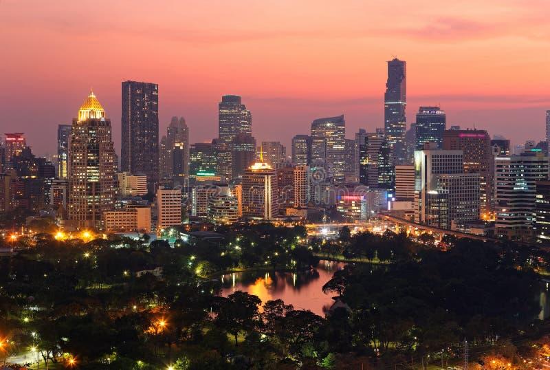 Urban skyline of Bangkok City at sunset, with famous landmark Mahanakhon Tower amid modern high rise buildings stock image