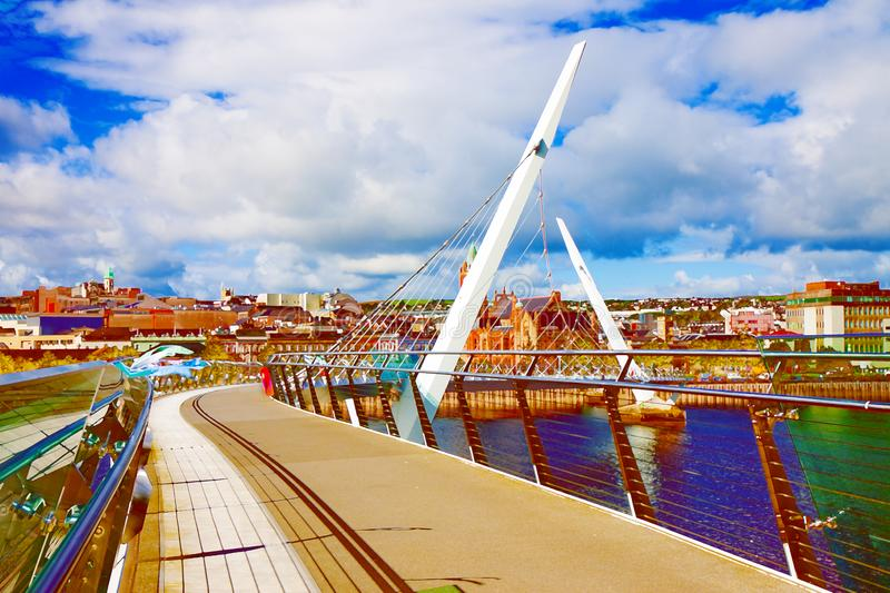 Urban skyline of Derry city also called Londonderry. In northern Ireland with the famous `Peace Bridge` Europe - Northern Ireland - Art Toned image stock image