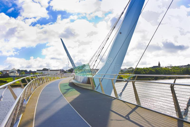 Urban skyline of Derry city also called Londonderry in northern Ireland with the famous. `Peace Bridge` Europe - Northern Ireland stock photo