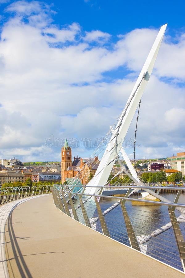 Urban skyline of Derry city also called Londonderry in northern Ireland with the famous. `Peace Bridge` Europe - Northern Ireland royalty free stock photos
