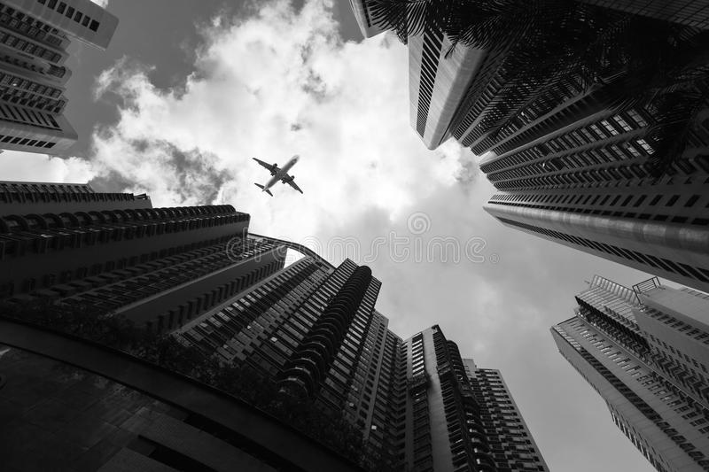 Urban skyline with passenger plane royalty free stock photo