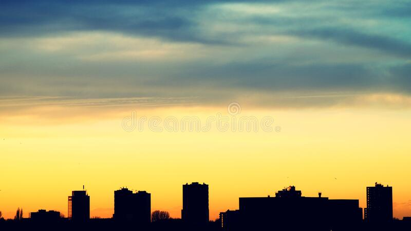 Urban skyline at sunset royalty free stock images