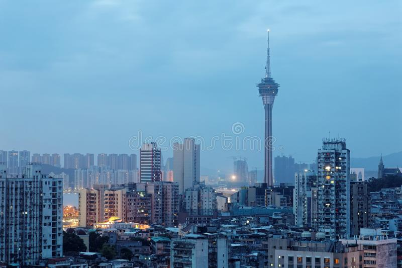 Urban skyline of vibrant Macau City in blue misty morning twilight, with the famous landmark Macau Tower stock photo