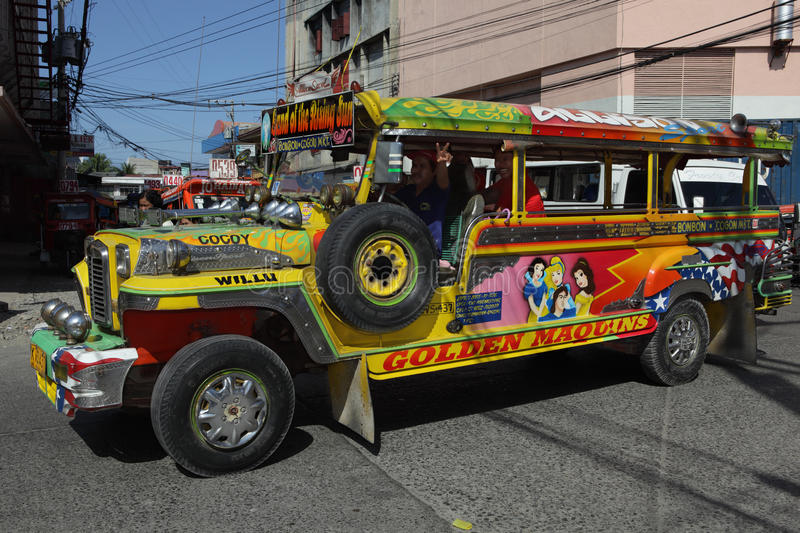 Urban Southern Filipino Jeepney. Colorful, flamboyant, psychedelic and typical Filipino urban jeepney in action on the street. Jeepneys are abundantly decorated stock photography