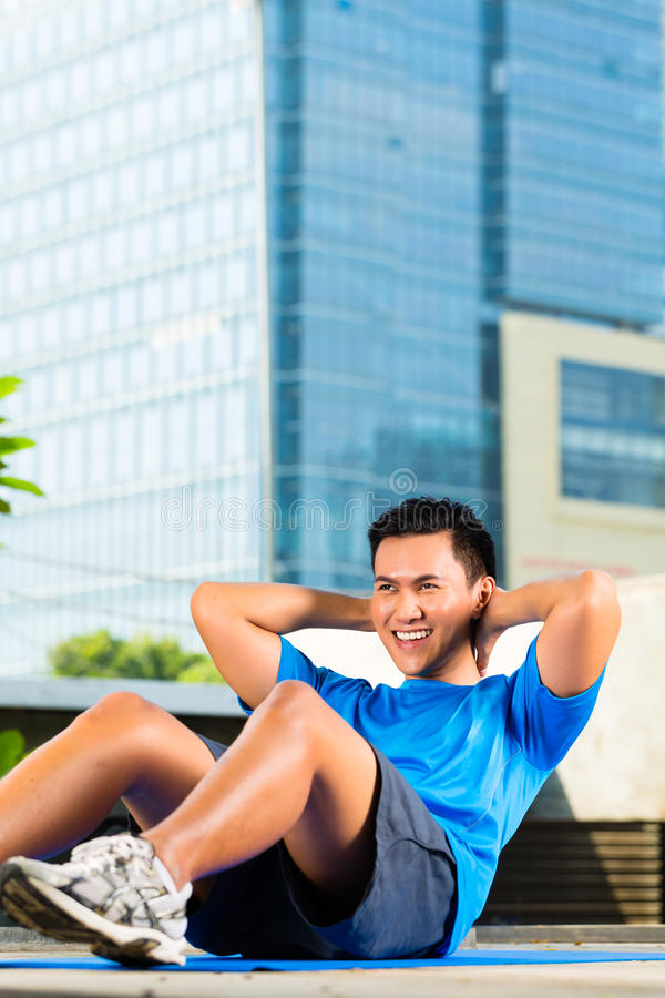 Urban sports - fitness in Asian or Indonesian city stock images
