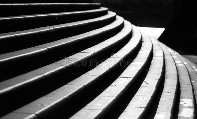 Urban stairs. Black and white of modern, curved urban stairs stock images