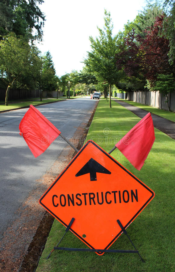 Urban street contruction. A sign warns of construction up ahead in an urban area of Vancouver, British Columbia stock photography