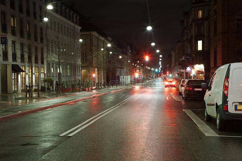 Urban street at night. With little traffic stock image