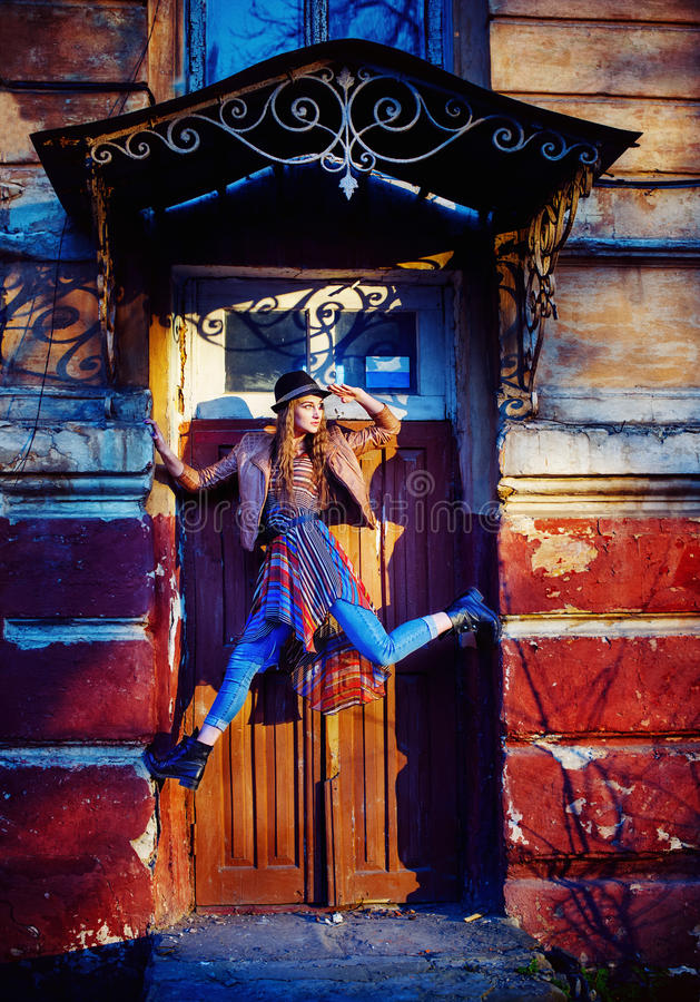 Urban style beautiful girl posing. While dancing stock photo