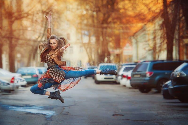 Urban style beautiful girl posing. While dancing stock photography
