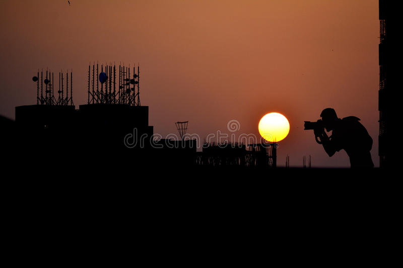 Urban Sunset and the Photographer. stock images