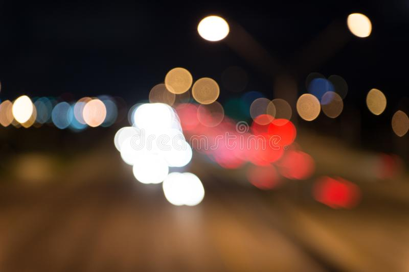 Urban traffic. Blurred car lights night. Urban night. Lights defocused background. Night city lights. Illumination and stock photography