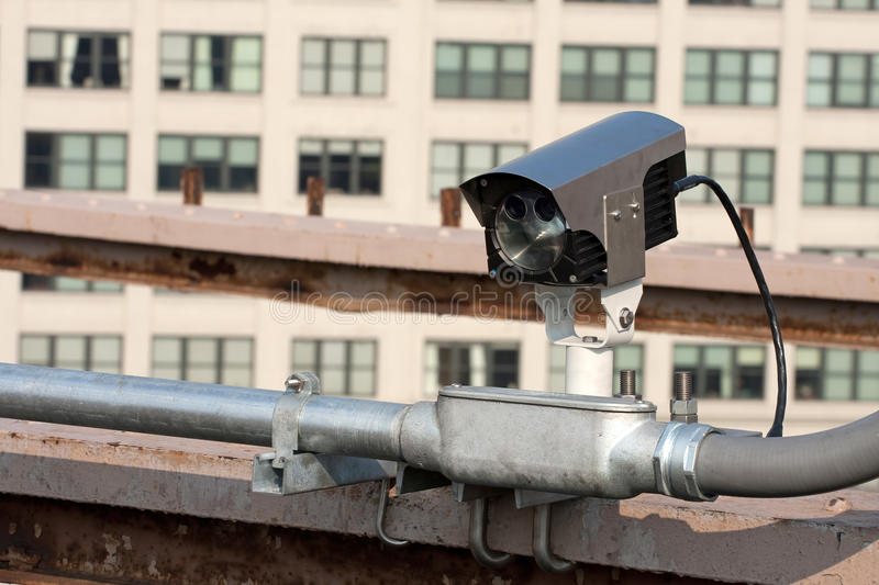 Urban Traffic Camera. A modern day traffic cam used for surveillance by governmental law enforcement authorities royalty free stock photos
