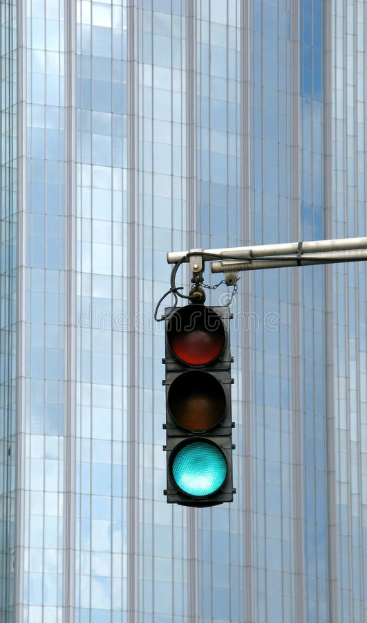 Free Urban Traffic Light On Green Stock Photos - 12343683
