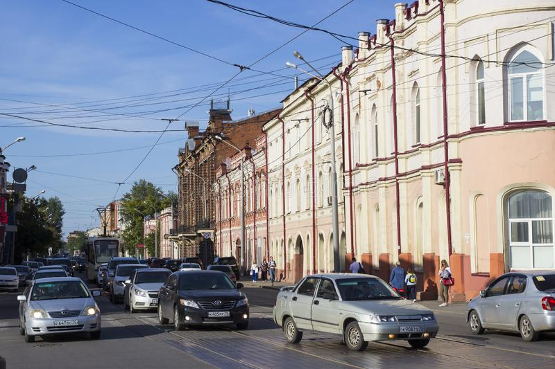 Urban transport on the road a small street of a provincial Russian city. Rosa Luxemburg street in the Siberian city of Tomsk stock images