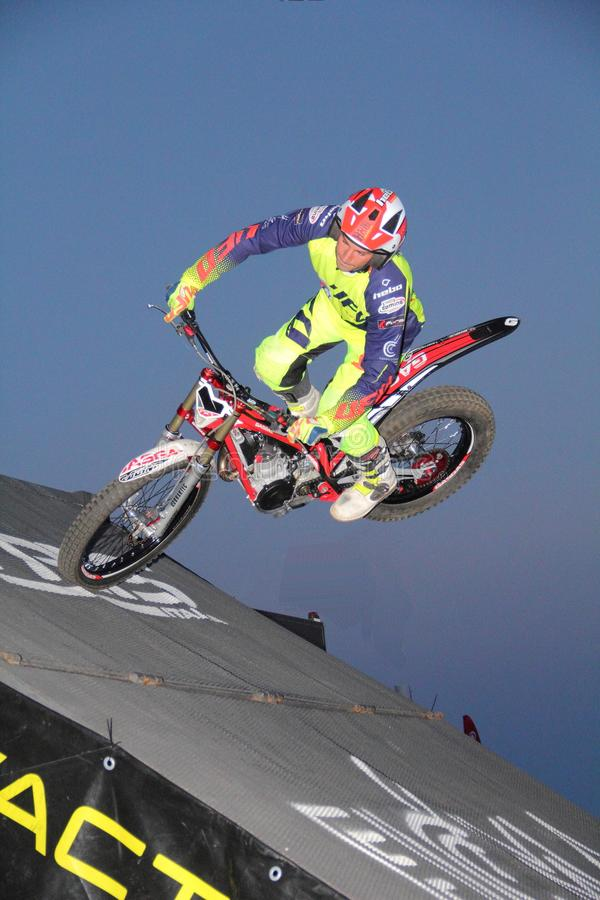 Urban trial motorcycling: a competitor engaged during the race stock photo