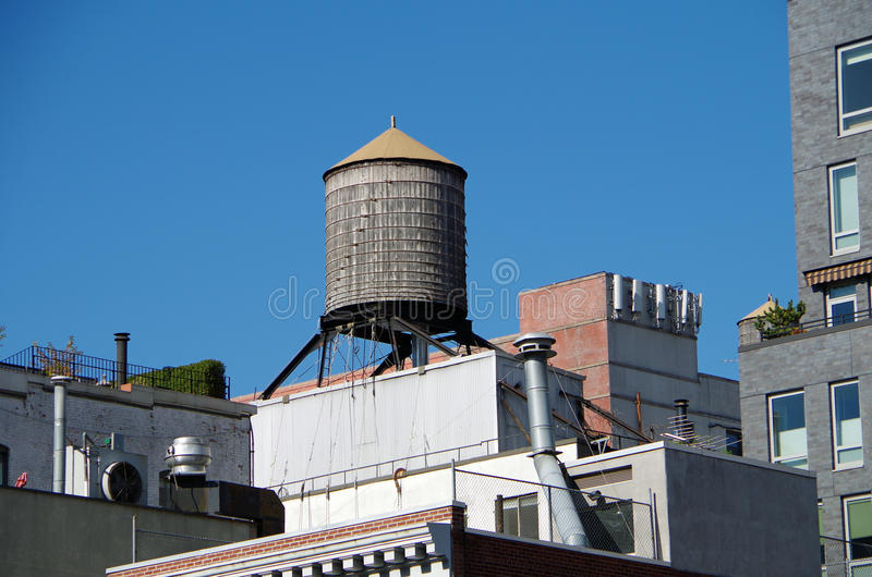 Urban water towers and rooftops stock image