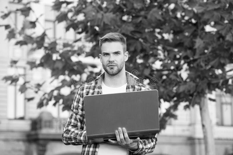 Urban WiFi. Digital solution for business. Entrepreneur developer inspired by nature. Man developer hold laptop. Inspired for start up. Handsome guy with stock photos