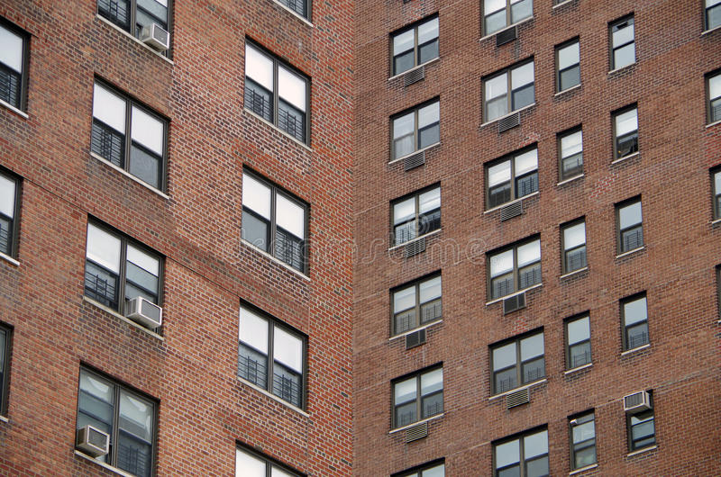 Urban window pattern. Looking up at a detail view of a nyc apartment buildings intersecting perspective royalty free stock photography
