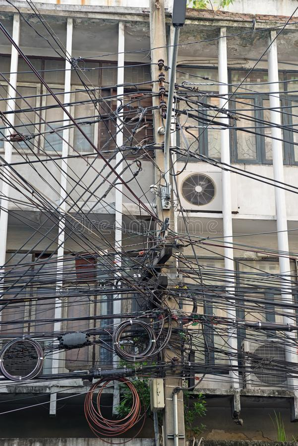 Urban Wiring. A tangle of electric and communication wiring in Bangkok Thailand stock image