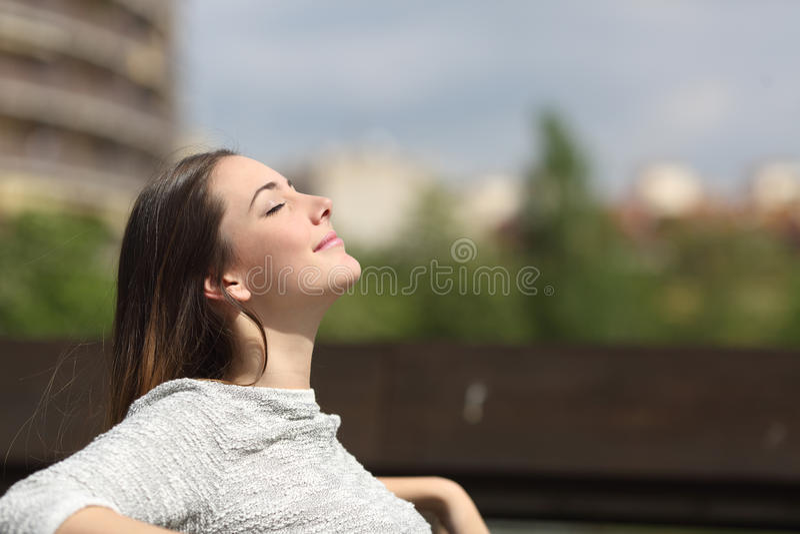 Urban woman breathing deep fresh air royalty free stock images