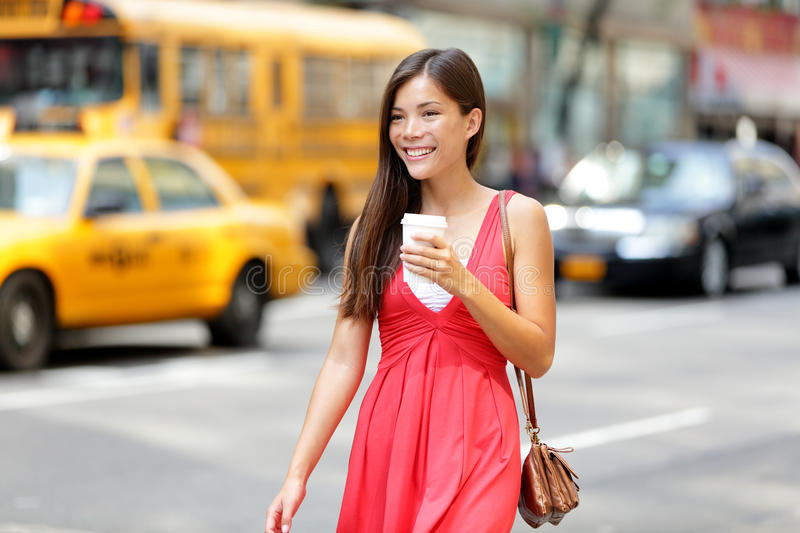 Urban woman drinking coffee in New York City royalty free stock images
