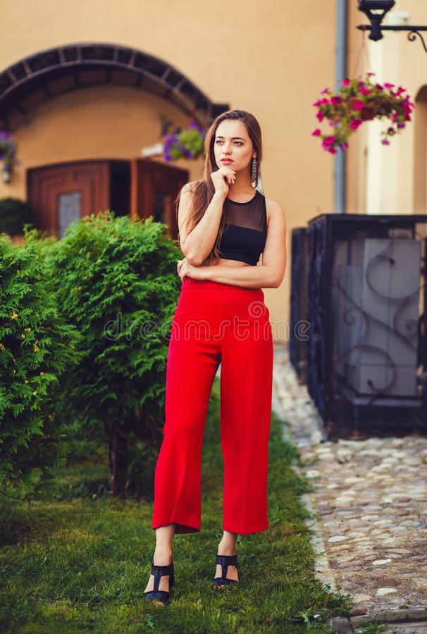 Urban woman in red pants stock photography
