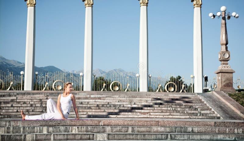 Urban Yoga Vakrasana Twisting Pose Royalty Free Stock Photography
