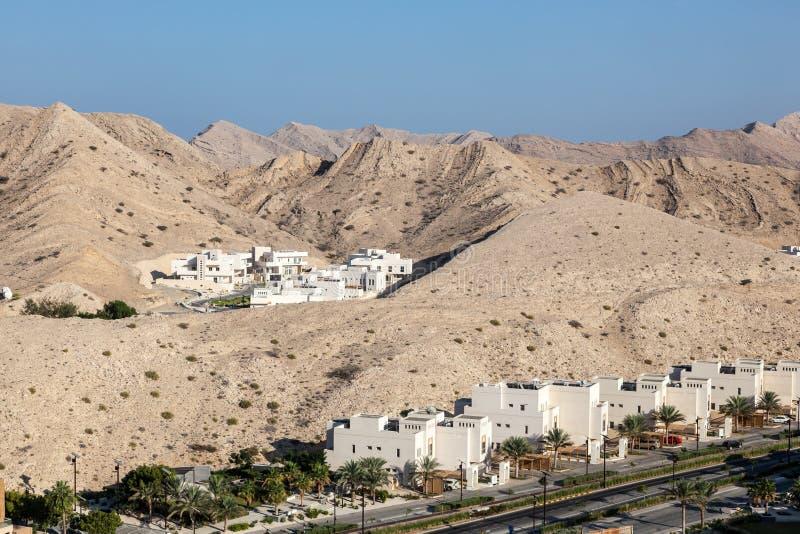 Urbanisatie in Muscateldruif, Oman royalty-vrije stock afbeeldingen