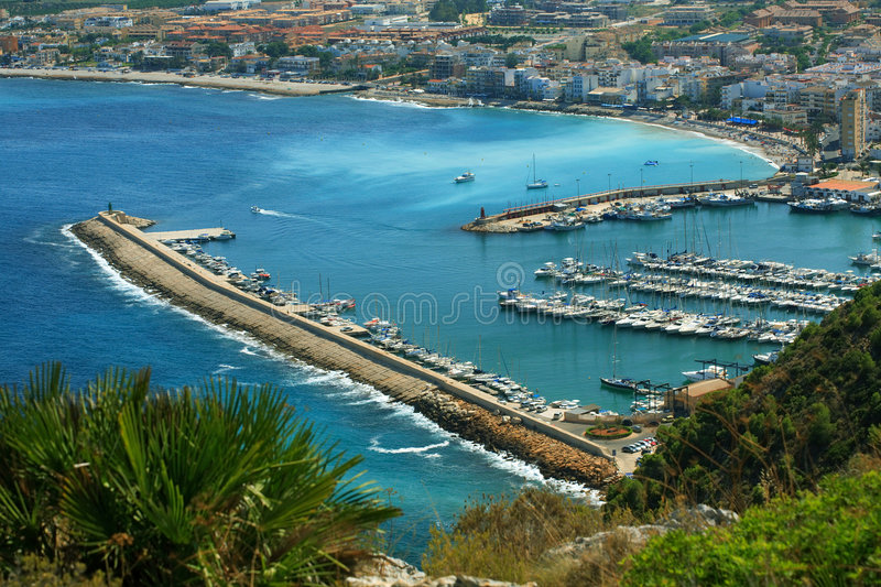 Urbanization of coastal city. Harbor stock photo