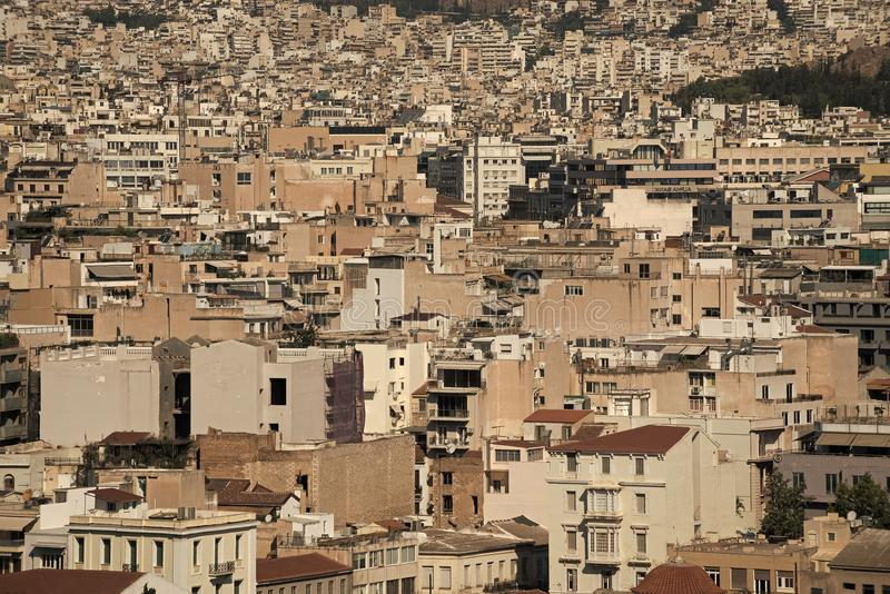 Urbanization concept. Dense urban areas in Greece, Europe. Many light buildings stand close each to other. Dense. Development of city, population density stock photography
