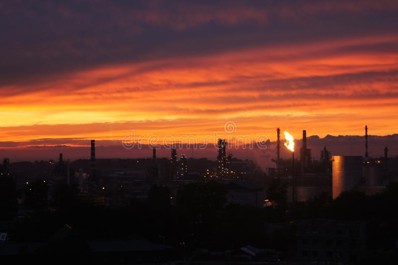 Urbanization. A red sunset. Far East of Russia. Khabarovsk. Urbanization. View of the plant. Unusual sunset royalty free stock images